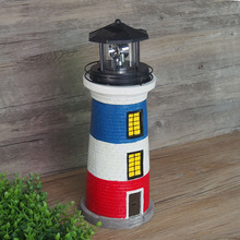 Amazon hot selling 360 rotating polyresin solar motion garden lighthouse