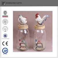 hen standing on glass jar polyresin decorative craft