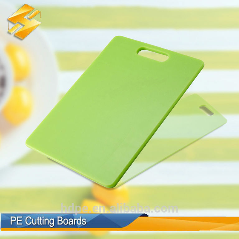 Small plastic cutting board for vegetable processing