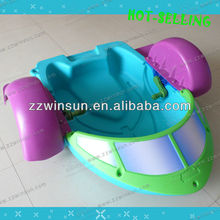 interesting children play hand aqua toy paddle boats