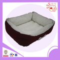 red plush dog bed with bone broidery