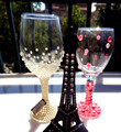 shining wine glasses with colorful diamond