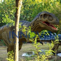 Giant moving mechanical animated dinosaur and dinosaur unearthed