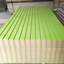 GROOVED MDF/ALUMINUM STRIPS INSERTED IN SLOT MDF