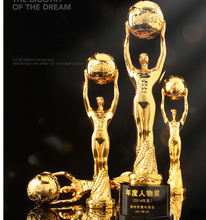 Gold man metal award trophy holding round metal globe ball with crystal base