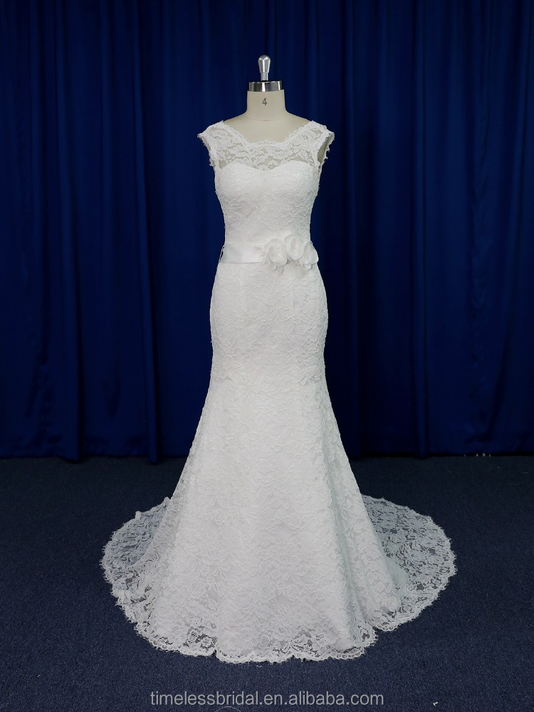 Classic tailored mermaid-style chantilly lace muslin wedding dress with flowered sash