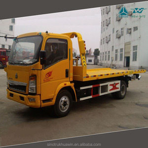 SINOTRUK HOWO flatbed recovery tow truck wrecker for sale in kenya