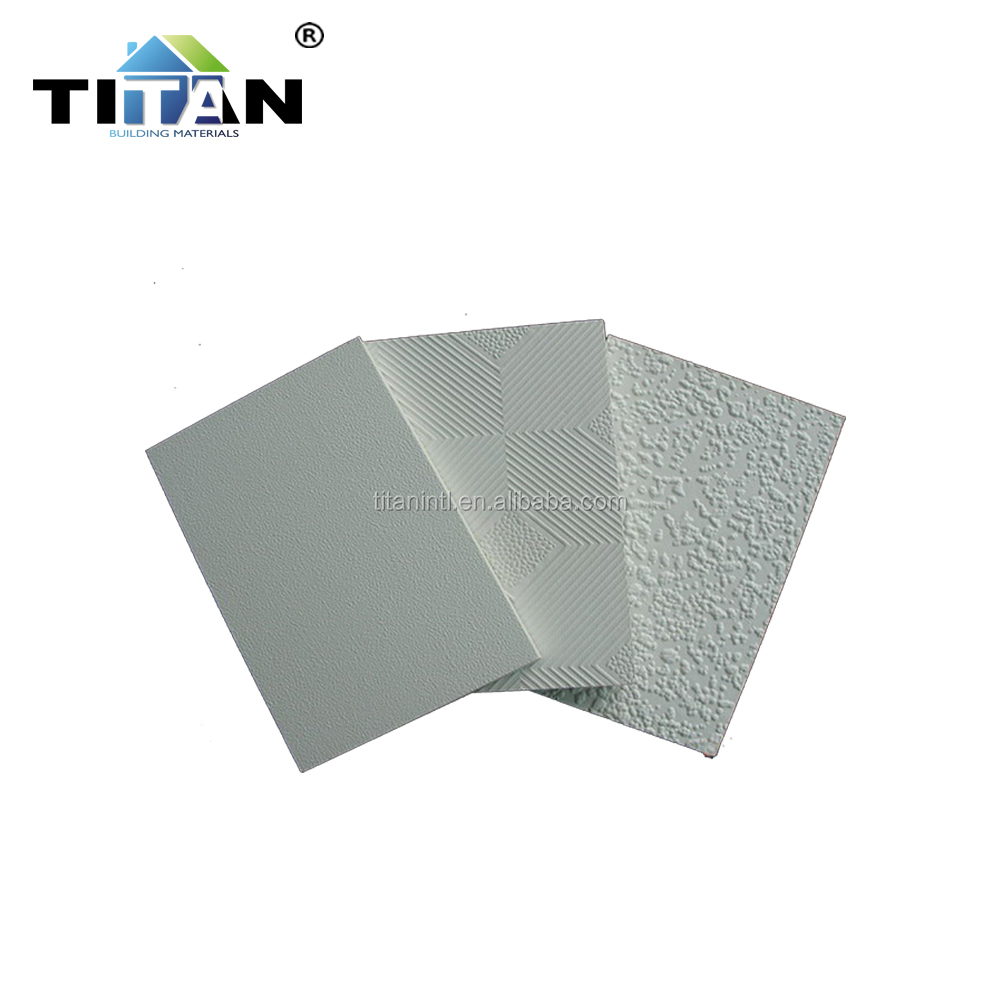Laminated gypsum ceiling tiles
