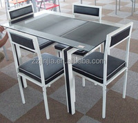 JJ-A0012 1+4 modern glass dining table and installation chair covers with square top powder coating leg