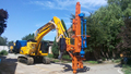 Excavator mounted drill rig