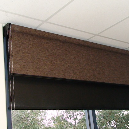 Dual roller shade with balckout window facing