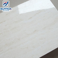 white and yellow porcelain tile that looks like travertine 600x600mm