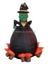 Inflatable Halloween decoration of green face devil in the water tank