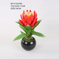 Artificial red silk protea flower with black ceramic pot