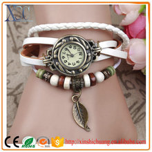 Promotion ladies leather wrist watches vintage women watches luxury with leaf pendant
