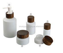 white coating glass bottles cosmetic packaging with wooden jar lids