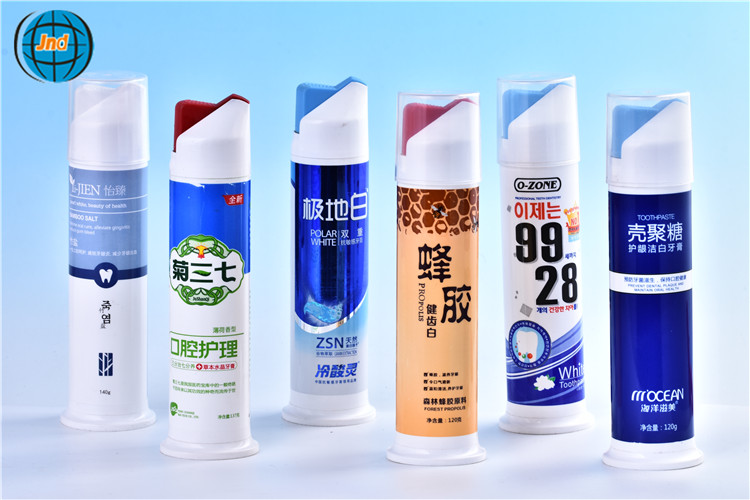 PP airless toothpaste bottle direct factory price by GMP standard plant with super offset printing and Patent Protection