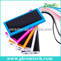 Solar battery charger for portable electronics with LED flashlight