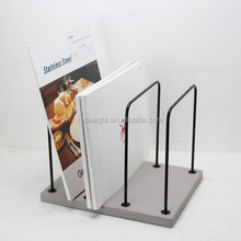Concrete Magazine Rack With Black Metal Stand
