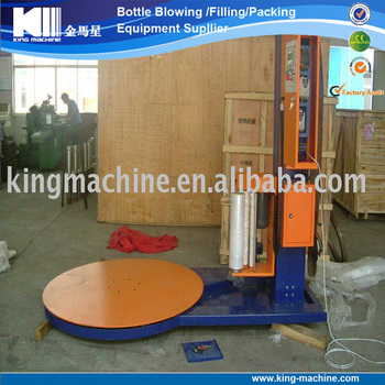 Mechanical strech pallet wrapping machine