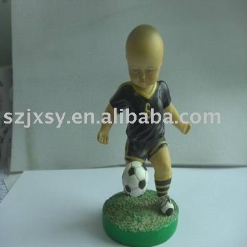 cute baby figurine/ the little boy with football