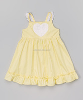 Plain yellow solid cotton backless dress for posh girl baby beautiful dress design