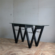 vagary glass top cinsole table with wood legs