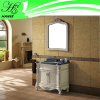 hand painted white bathroom vanity with marble top and vessel sink
