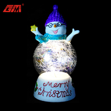Battery operated lighted custom made glass snow globe with resin snowman and base for christmas decoration