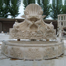 Hot sale outdoor stone nude boy and fish sculpture water wall fountains