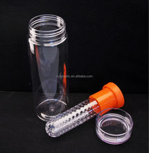 Fruit and vegetable infuser sits in middle of water bottle