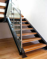 modern functional stairway with glass balustrade for indoor design