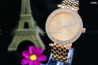 Gold-Tone Diamond and Crystal-Accented Watch with Gold Satin Band watch