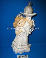 White ceramic angel with candle holder