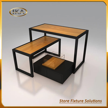 Unique design customized size stainless steel and MDF PD material clothing display table