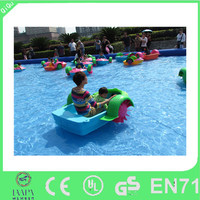kids use small plastic inflatable paddle boat for water park
