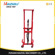 China Factory Manual Drum Lifter, 350kg Hydraulic drum forklift carrier stacker price