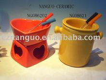 ceramic fondue pot at heart shape with fork