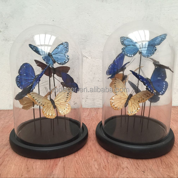 glass dome with artificial butterflies inside for home decoration