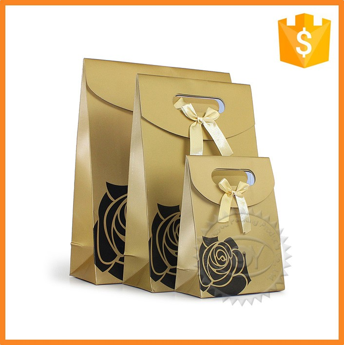 Popular customized fancy cosmetic paper pouch bags for gifts