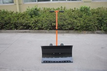 Metal snow shovel with pneumatic wheel used for cleaning snow