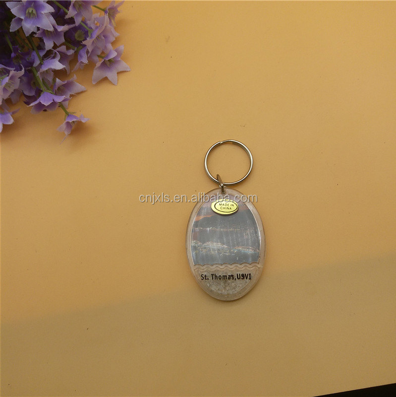 Acrylic Key chain , oval shape with sands for souvenir