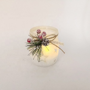 Glass candle holder with metal lid cover