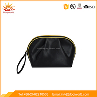 black satin material cosmetic bag with golden color piping