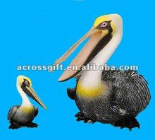 Decorative resin pelican with little child