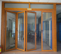 Wood color surface treatment aluminium profile 70 series glass folding doors for balcony doors