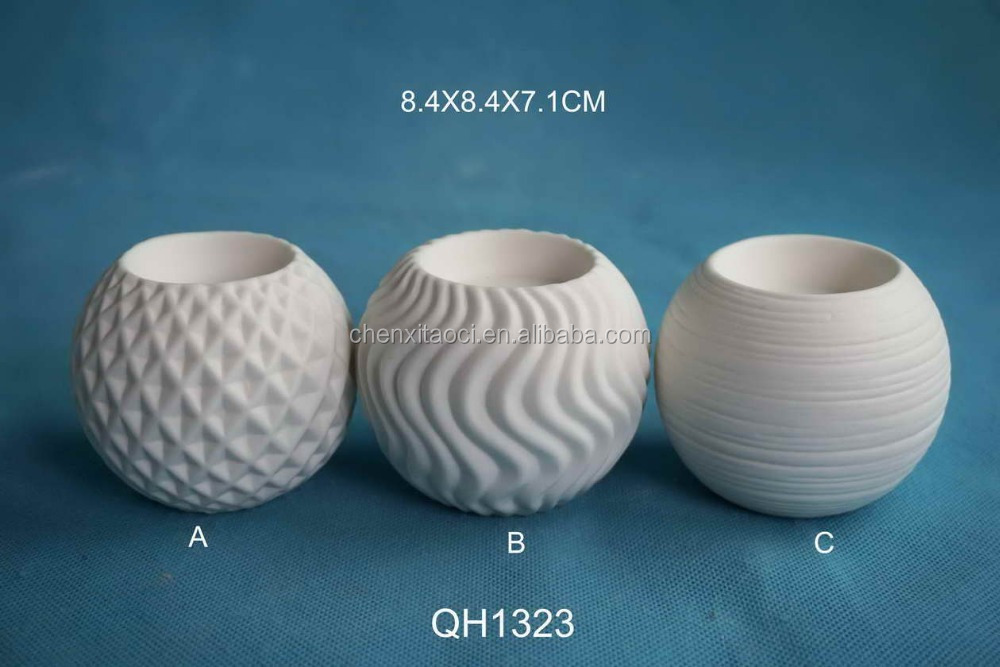 White ceramic decorative candle holder with different texture design buy candle holder - A buying guide for decorative candles ...