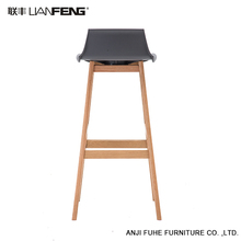 Good quality high PP plastic bar stool chair with wooden legs