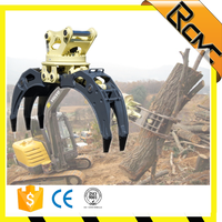 Rotating excavator hydraulic wood grapple for scrap trees