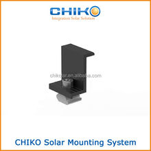 Adjustable solar module end clamp